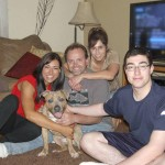 Pluto with his new adopted family, the Rosenbarkers. (photo provided)
